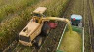 4K Aerial: Top Passing Corn machines video