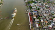 aerial top view of container transportation ship on chao phraya river, transportation concept, tilt-up camera shot, HD video