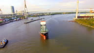aerial top view of container transportation ship on chao phraya river, transportation concept, tracking camera shot, HD video