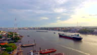 aerial top view of container transportation ship on chao phraya river at twilight or evening time, transportation concept, tracking camera shot, HD video