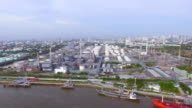 aerial top view of Oil refinery or factory and container transportation ship on chao phraya river, transportation concept, panning camera shot, HD video