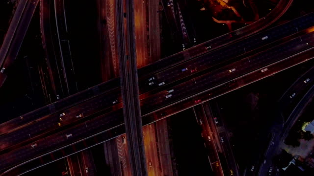 Aerial top view of traffic light on the highway at dusk video