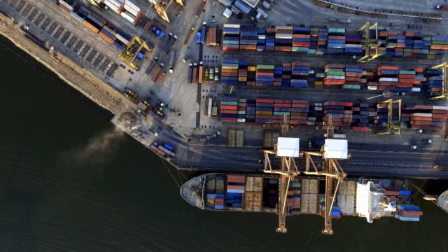 Aerial topdown shot of large bangkok shipping port taken in afternoon video
