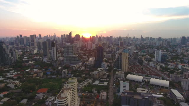 Aerial traffic urban scene over cityscape at sunset. video