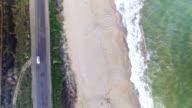 Aerial upside down view of sea coast and road with cars video