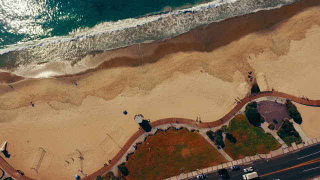 Aerial vertical look down on the pacific coast boardwalk in Laguna Beach California. video