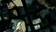 Aerial vertical view of skyscrapers and streets in a Metropolis video
