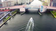Aerial video of a boat going under bridge video