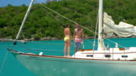 aerial video of a couple on sailboat in the Caribbean video