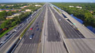 Aerial video of a highway with hov lanes video