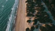 Aerial video of an Italian wild beach at sunset video
