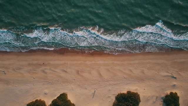 Aerial video of an Italian wild beach at sunset video