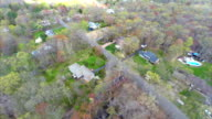 Aerial video of houses in the woods video