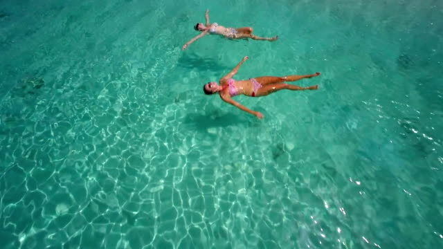 aerial video of women floating at Sandy Spit, BVI video