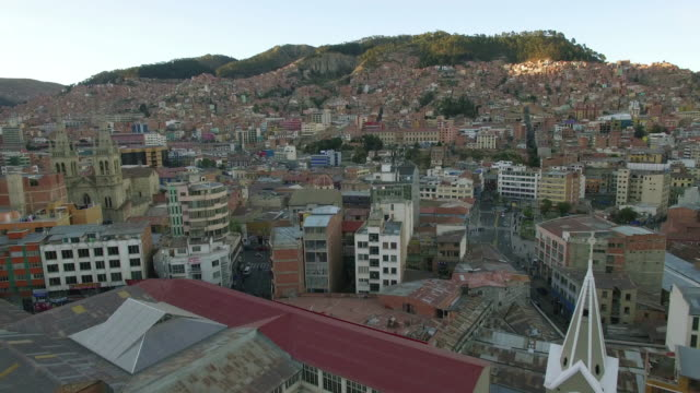 4K Aerial view bolivia above houses church toward hills video