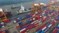 Aerial view Container Cargo freight ship with working crane bridge in shipyard video