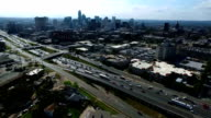 Aerial View Drone Filming Traffic on Interstate 35 or i35 Austin Texas Central Texas Capital Cities Skyline Cityscape 2016 video