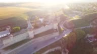 Aerial view Flying camera over of the old castle. Ukrine. aLviv. Pidgirtsi. Travel tourism adventure in wild nature camera bird eye view video