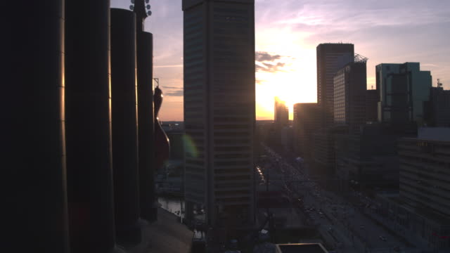 Aerial view flying over downtown Baltimore at Sunset video