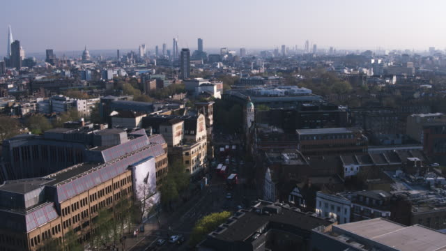 Aerial view flying over downtown city streets London video