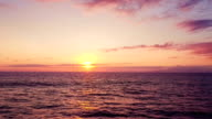 Aerial View Flying Over Ocean Into Dramatic Sunset video