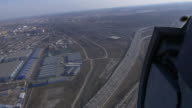 Aerial view from helicopter fly above city. Height. Motorway with cars, road junction. Sunny day video