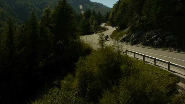 Aerial view group of motorists riding on the winding road video