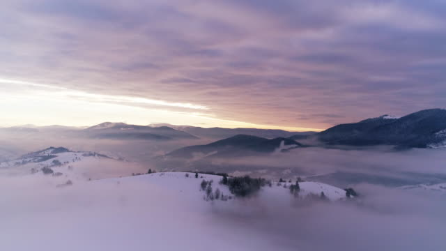 Aerial view in foggy sunset winter mountain video