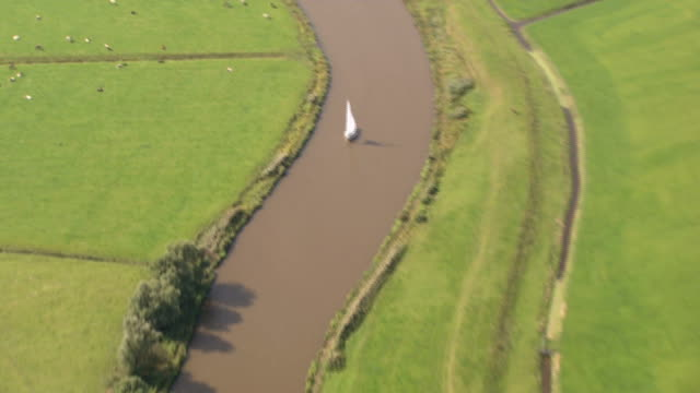 Aerial view landscape, river, boat, farmland, grassland, meadow video