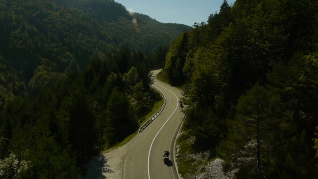 Aerial view motorists driving on the winding road video