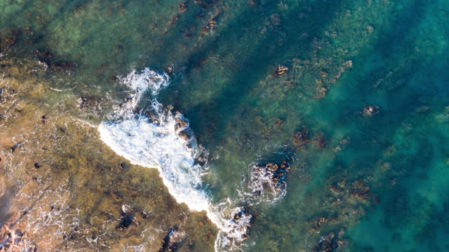 Aerial View Ocean Waves Crashing On Rocky Shoreline video