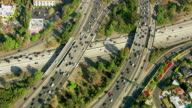 Aerial view of a busy freeway intersection video