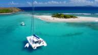 Aerial view of a Catamaran at Sandy Spit, BVI video