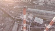 Aerial view of a coal fire power station and moscow city panoramic. Smoke pipes. Moscow, Russia. Sunrise sunset day. Air Pollution From Industrial Plants. Large Plant on the Background of the City. video