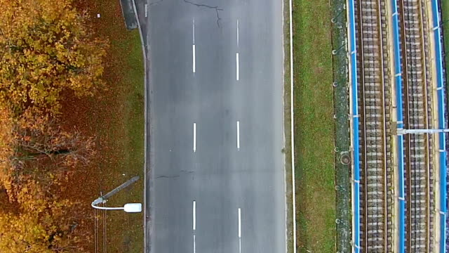 Aerial view of a highway with one car on it video