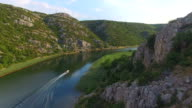 Aerial view of a motorboat speeding on Zrmanja river, Croatia video