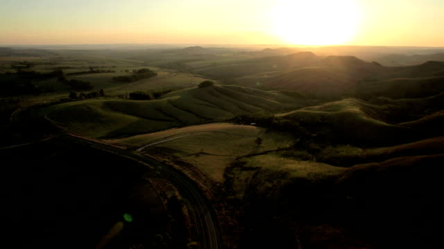 Aerial view of a road at sunset video