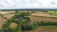 Aerial view of a rural area with scattered houses and fields video