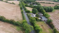 Aerial view of a rural road with scattered houses and fields video
