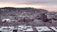 Aerial view of a sunset over a snow covered city video