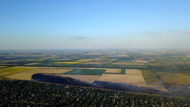 Aerial View Of Agricultural Field Burning, Yellow Grass In Smoke And Fire video