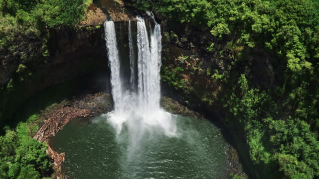 Aerial view of amazing waterfall in tropical rain forest jungle video
