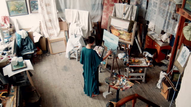 Aerial view of an artist in her studio video