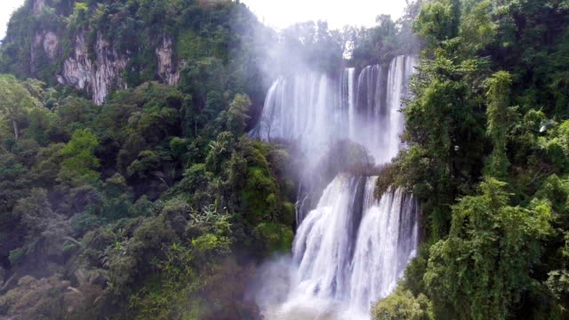 Aerial View of Attractive Great Waterfall with Rainbow in Deep Forest, Thi Lo Su, Umphang, Thailand. Tilt up Shot. video