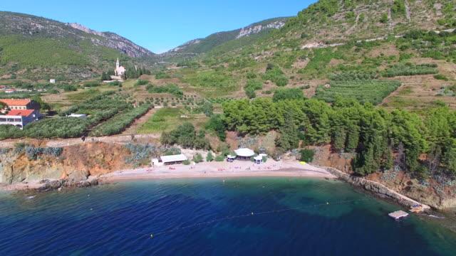 Aerial view of beach at Komiza on Island of Vis, Croatia video