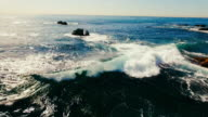Aerial view of beautiful Laguna Beach's waves breaking in the summer sun. video