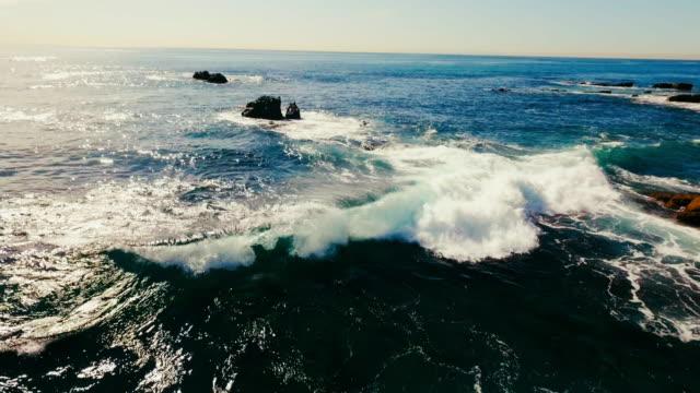 Aerial view of beautiful Laguna Beach's waves breaking in the summer sun. video