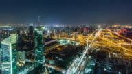 T/L WS Aerial View of Beijing CBD and Road Intersection at Night video