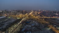 T/L WS HA Aerial View of Beijing Road Intersection, Day to Night Transition / Beijing, China video