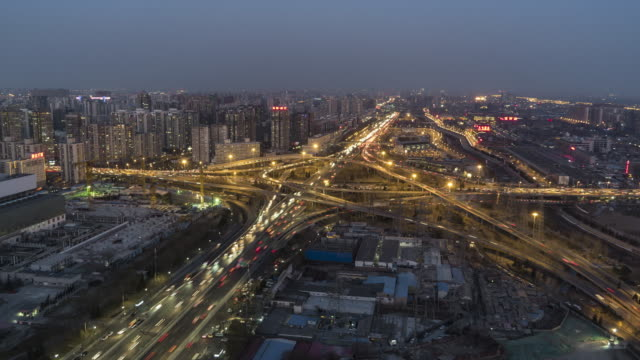 T/L WS HA PAN Aerial View of Beijing Road Intersection, Dusk to Night Transition / Beijing, China video